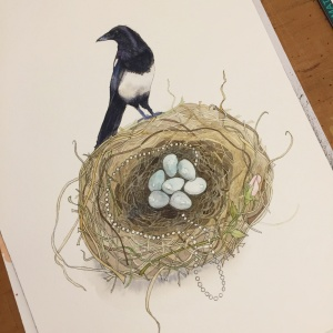 A photograph showing the magpie watercolour painting with the inking half finished